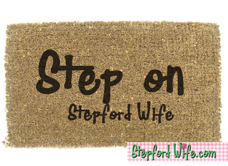 stepford wife doormat.  step on me